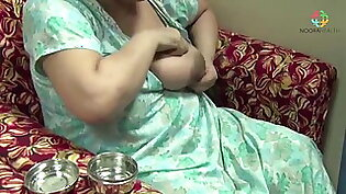 Busty Indian lady squeezing milk from big boob