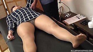 Lovely brunette babe gets her sexy body massaged by a kinky guy