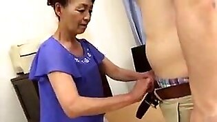 Wild Asian granny has a young man taking care of her needs