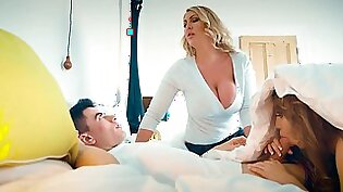 A blonde with huge boobs is with her stepdaughter, fucking